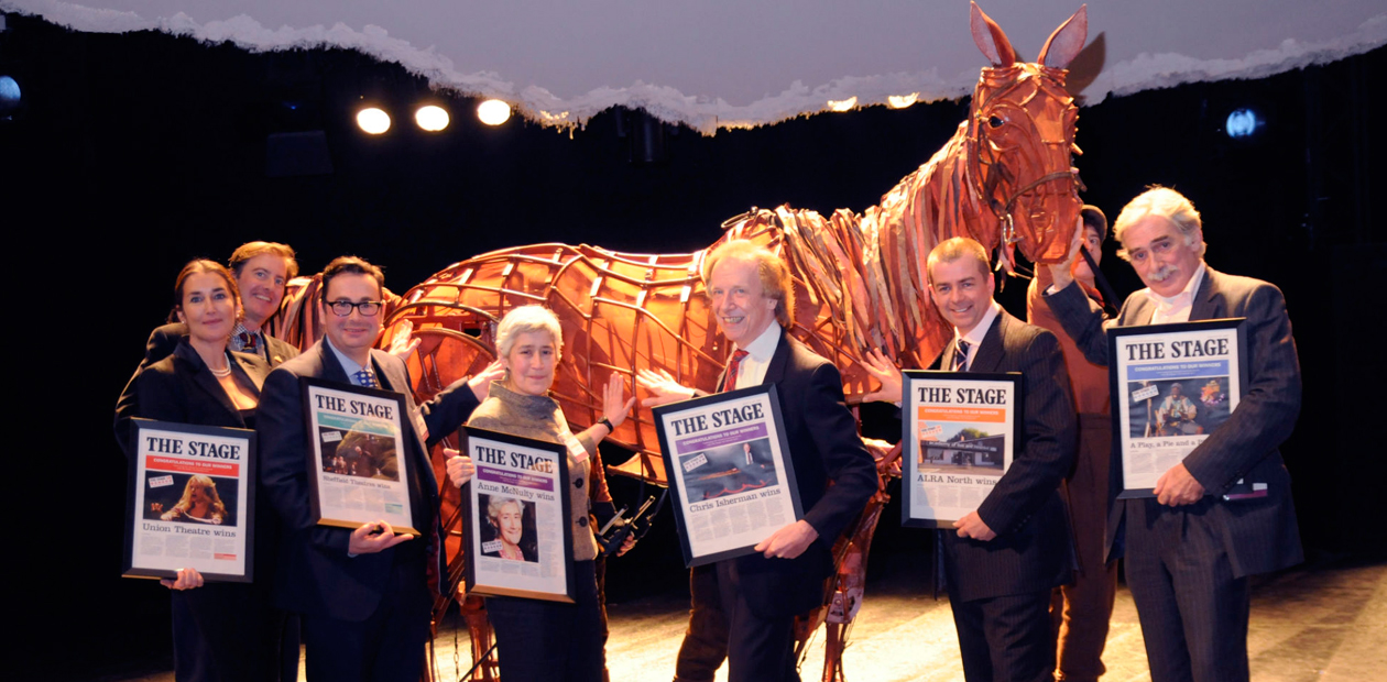 Stage Award winners earlier this year (l-r) Sasha Regan, Neil Constable, Dan Bates, Anne McNulty,   Chris Isherman, Adrian Hall and David MacLennan with the star of War Horse, Joey. Photo: Stephanie Methven