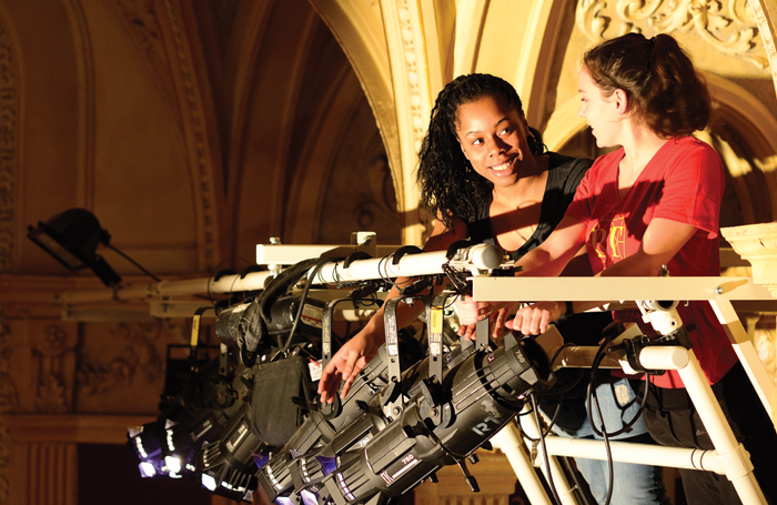 ATG technical apprentices Tamykha Patterson and Marianne Nightingale working in one of the company's venues