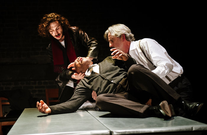 Billy Postlethwaite, Burt Caesar and Martin Turner in The Plague at the Arcola Theatre, London. Photo: Alex Brenner