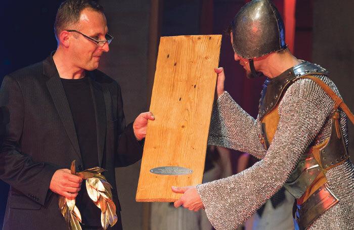 Rastislav Ballek, winner of best director at the 2015 Doskys in Slovakia, with the ceremony's host Juraj Duris. Photo: Ctibor Bachraty