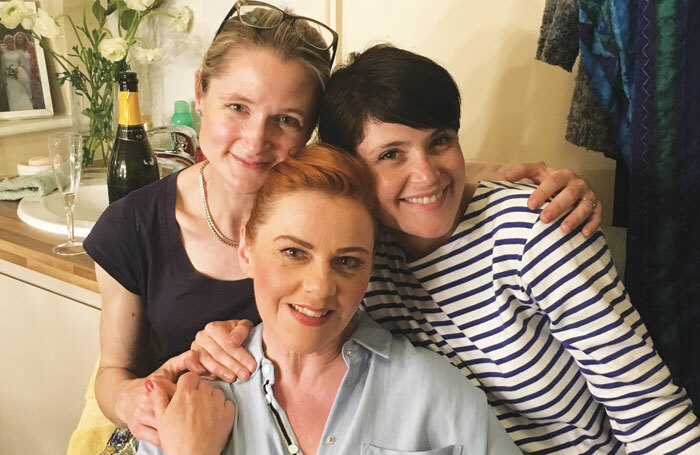 Actors Naomi Frederick and Gemma Arterton visit cast member Sophie-Louise Dann (centre) backstage at The Girls at London's Phoenix Theatre