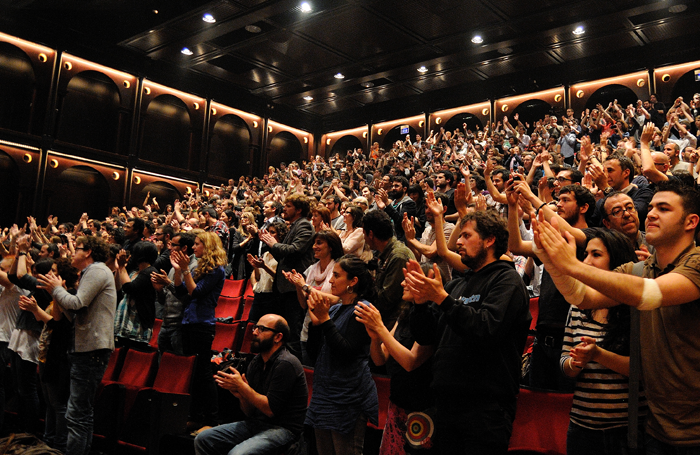 An audience giving a standing ovation – could they be the future of criticism? Photo: Christian Bertrand/Shutterstock