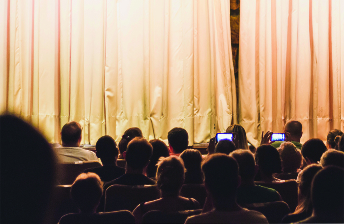 Audiences are increasingly using mobile phones once the curtain is up. Photo: Shutterstock