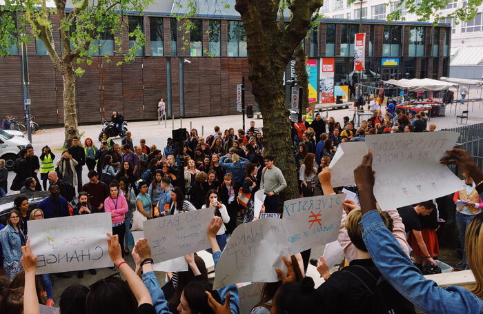 Students and staff gathered outside Central on May 11 in support of systematic change within the institution