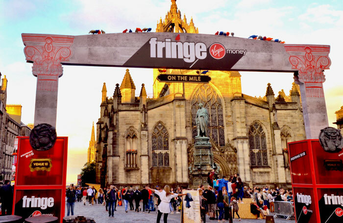 The Royal Mile with St Giles Cathedral in the background during the 2018 Edinburgh Festival Fringe. Photo: Lou Armor/Shutterstock