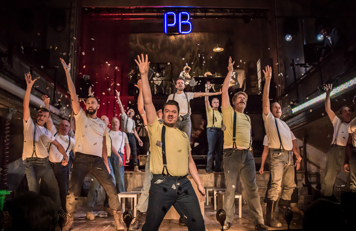 The ENO Chorus in Paul Bunyan at Wilton's Music Hall, London. Photo: Genevieve Girling