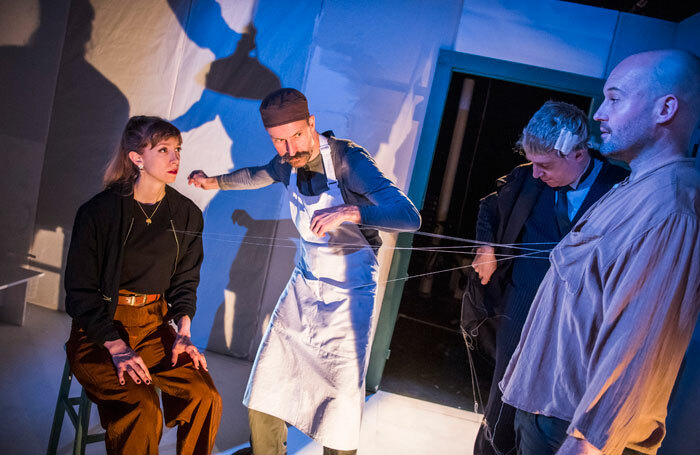 Shamira Turner, Tom Lyall, Simon Kane and Greg McLaren in An Execution (by Invitation Only) at Camden People's Theatre. Photo: Tristram Kenton