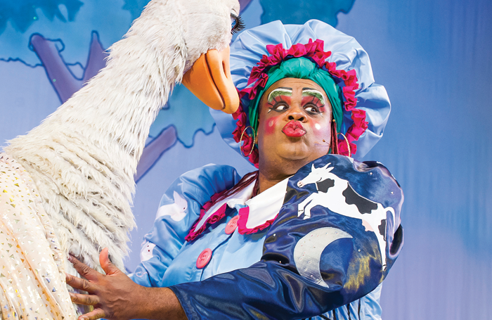 Clive Rowe in Mother Goose: The dames' increasingly outrageous costumes are fundamental to a successful pantomime. Photo: Tristram Kenton