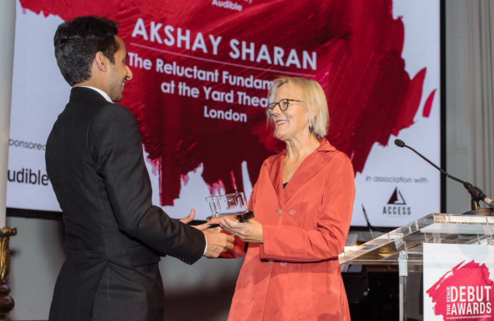 Director Phyllida Lloyd (right) presents Akshay Sharan with The Stage Debut Award for best actor in a play. Photo: David Monteith-Hodge