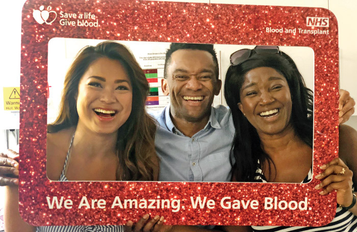 Hamilton cast members Marsha Songcome,  Jason Pennycooke and Rachel John give blood at Edgeware Community Hospital. Photo: Callum Stephen PR