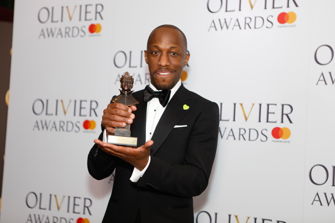 Giles Terera picking up his Olivier award for best actor in a musical. Photo: Pamela Raith