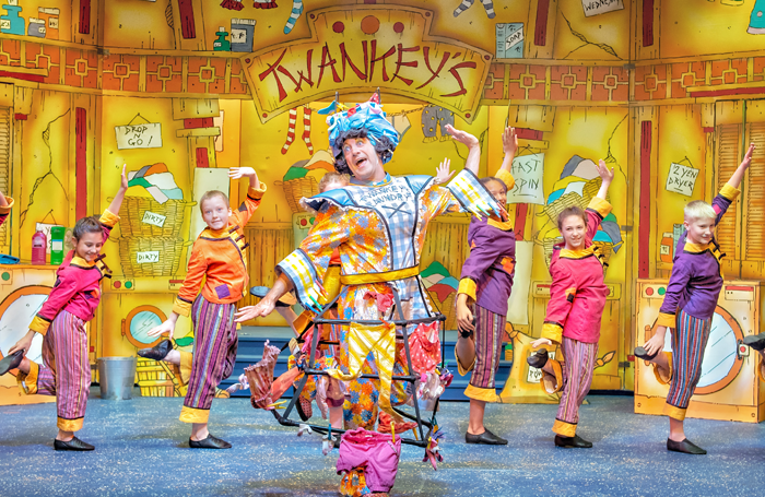 Robin Simpson with the young company in Aladdin at Lawrence Batley Theatre. Photo: Anthony Robling