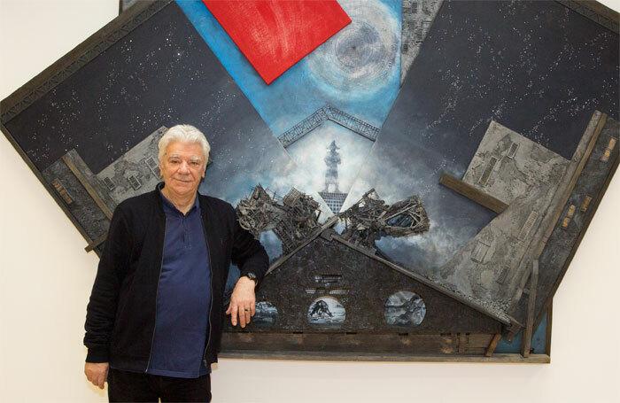 Designer John Napier, in front of art work for his original design for Les Miserables