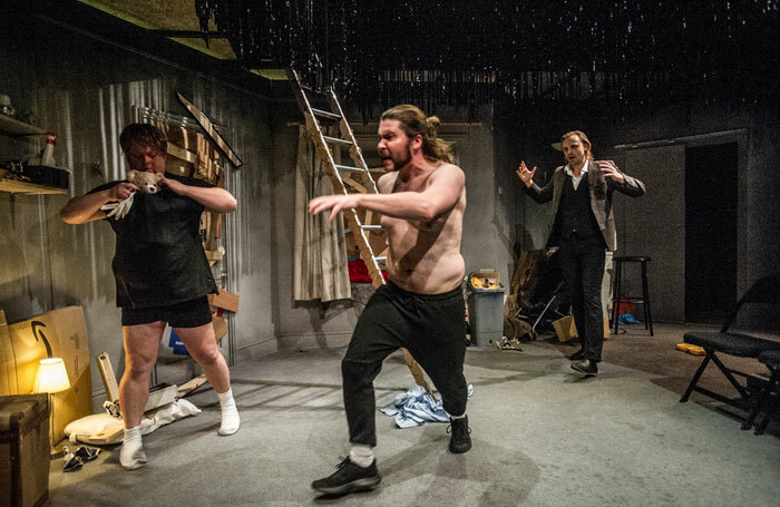 Danny Kirrane, Daniel Portman and Tom Canton in We're Staying Right Here at Park Theatre, London. Photo: David Gill