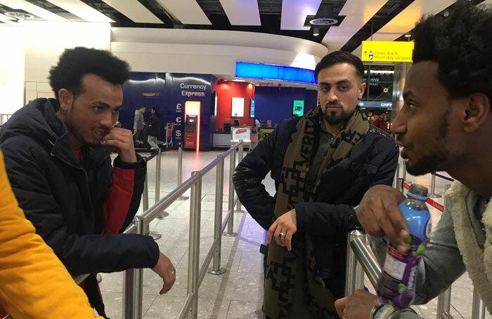 Phosphoros Theatre members Goitom Fesshaye, Syed Haleem Najibi and Tewodros Aregawe pictured at Heathrow Airport