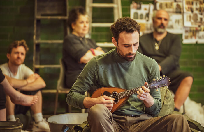 Alex Mugnaioni in rehearsals for Captain Corelli's Mandolin. Photo: Marc Brenner
