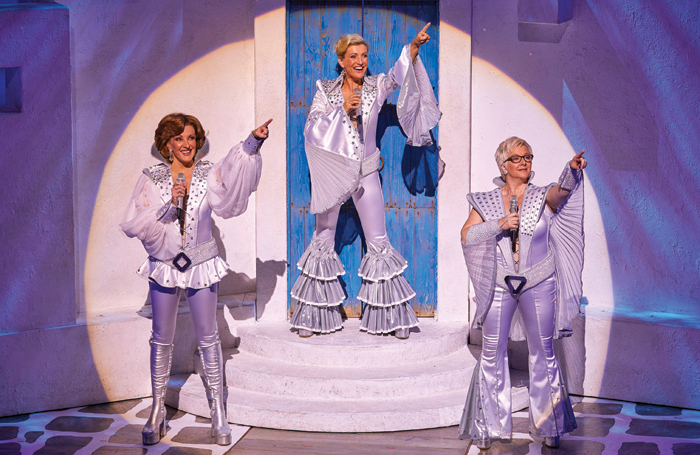 Kate Graham, Sara Poyzer and Ricky Butt in Mamma Mia! at the Novello Theatre, London. Photo: Brinkhoff Mögenburg