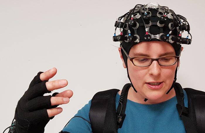Antonia Hamilton wearing the brain-imaging equipment