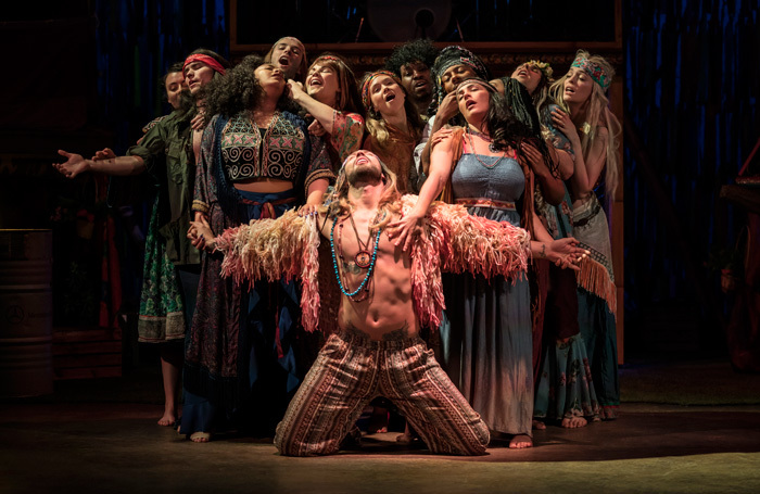 Jake Quickenden as Berger, centre, in the touring production of Hair. Photo: Johan Persson