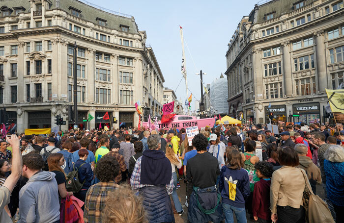 Supporters of climate change group Extinction Rebellion surround a boat blocking London's Oxford Circus as part of a series of protests across the capital. Photo: Shutterstock