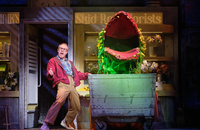 Joshua Lay and Audrey II in Little of Horrors at Storyhouse, Chester
