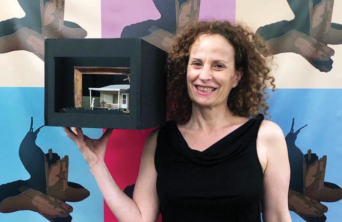 Artistic director Maria Striar wth a model box for Plano