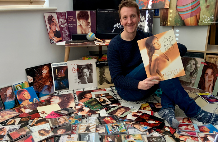 Matt Hemley with his collection of Gloria Estefan albums and memorabilia