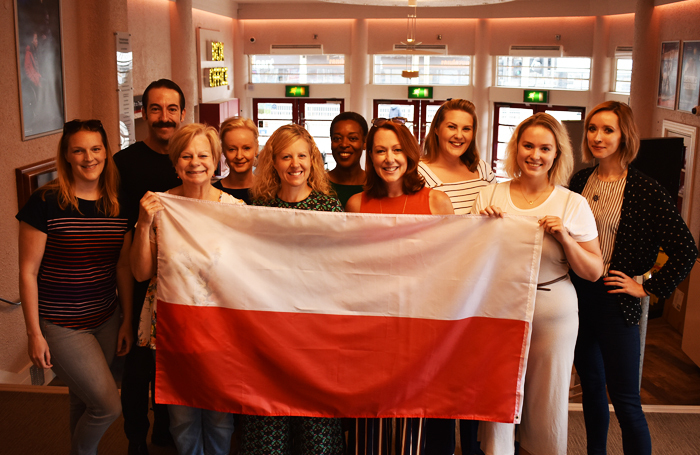 The cast of Stepping Out with a polish flag