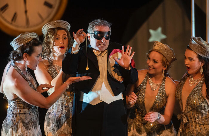 Peter van Hulle and members of the chorus in Die Fledermaus at West Green House