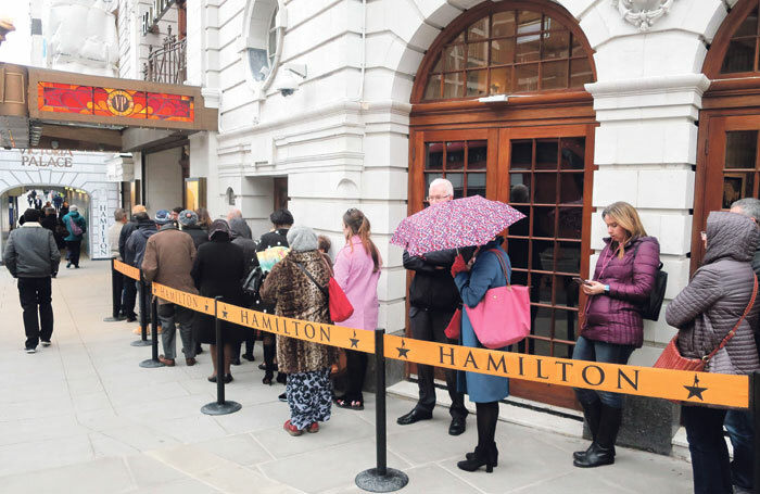 Audiences queuing outside the Victoria Palace Theatre in London to see a matinee performance of Hamilton. Photo: Shutterstock