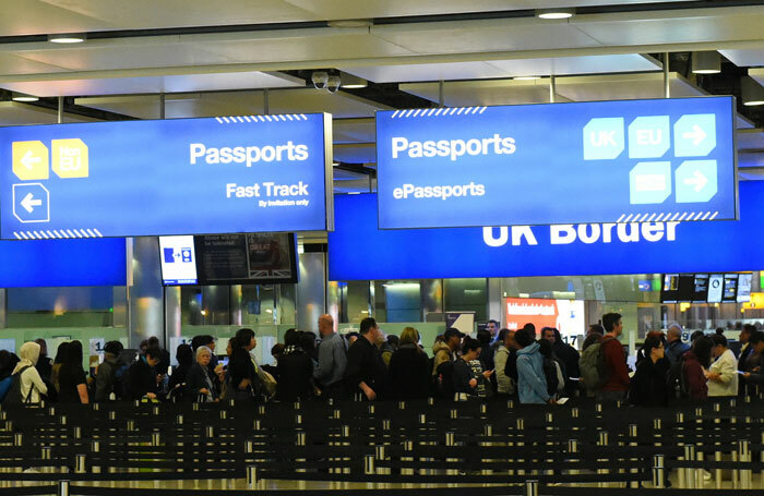 Airline passengers queue at border control at Heathrow Airport. Photo: Shutterstock