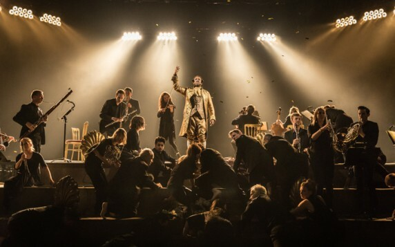 A scene from Amadeus, centre Lucian Msamati as Antonio Salieri with members of the Southbank Sinfonia. Photo by Marc Brenner