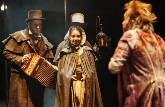 Tim-van-Eyken-(Nicholas),-Sienna-Kelly-(Jess)-and-Rhys-Ifans-(Ebenezer-Scrooge)-in-A-Christmas-Carol-at-The-Old-Vic