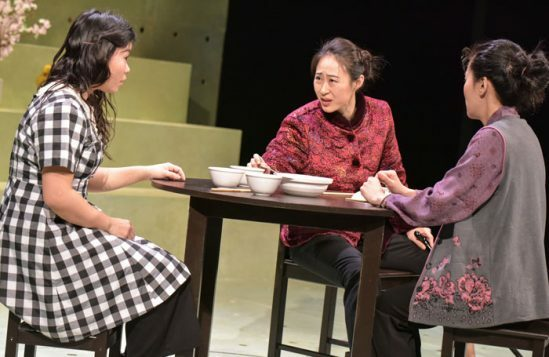 Mei-Mac,-Minhee-Yeo-and-Charlotte-Chiew-as-Wei,-Grandmother-and-Dong-in-Under-the-U