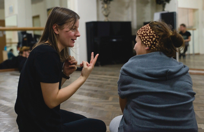 Ksenia Plyusnina of Social-Artistic Theatre teaches young people at an acting workshop