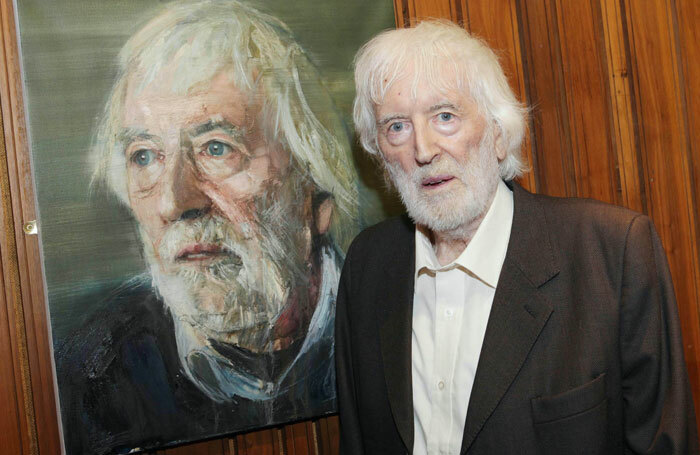 Tom MacIntyre beside his portrait by Colin Davidson in the Abbey Theatre. Photo: Brian McEvoy