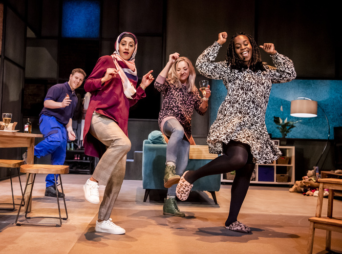 Thomas Coombes, Manjinder Virk, Claire-Louise Cordwell and Petra Letang in A Kind Of People at the Royal Court, London. Photo: Tristram Kenton
