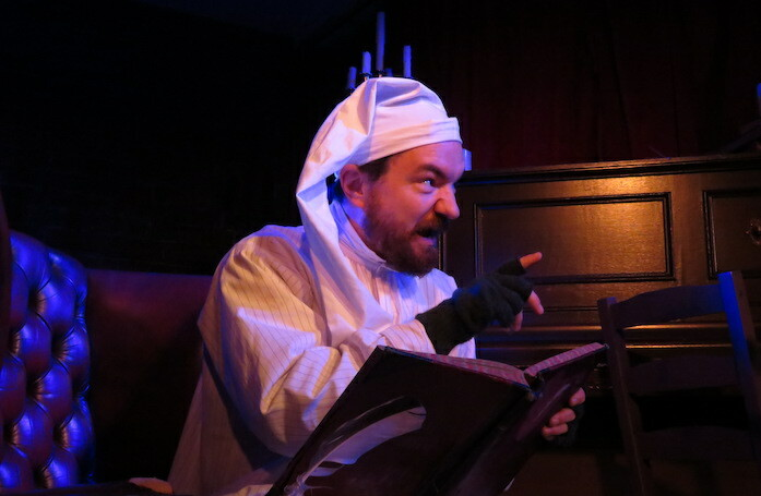 Dominic Allen in A Christmas Carol: The Immersive Dining Experience. Photo: Steve Stevens