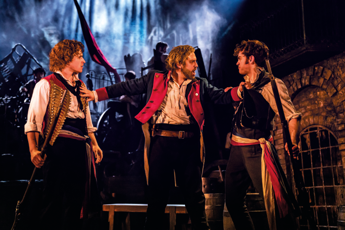 Ashley Gilmour, Jon Robyns and Harry Apps in Les Misérables. Photo: Johan Persson