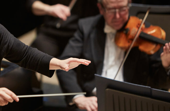 Dalia Stasevska conducts the orchestra of Opera North. Photo: Justin Slee
