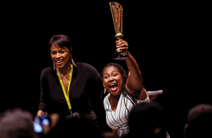 Tonia Daley-Campbell (right) receiving her prize at Enter Stage Write in 2018 with founder Natalie Edwards (left). Photo: Helen Young