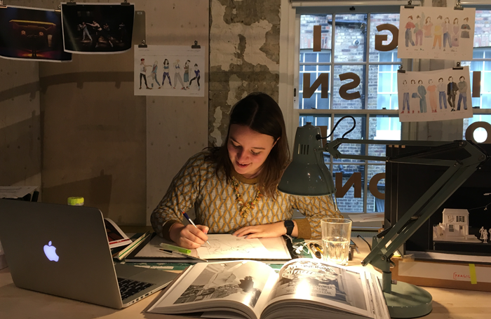 Grace Smart at work. Designers are getting booked later and later, she says, with resulting brain ache due to the pressures of time. Photo: Frankie Bradshaw