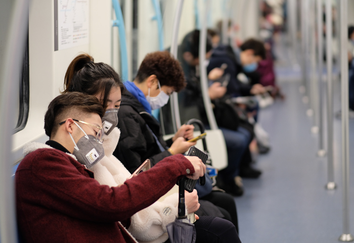 People wearing surgical masks on the subway in Shanghai. Photo: Shutterstock