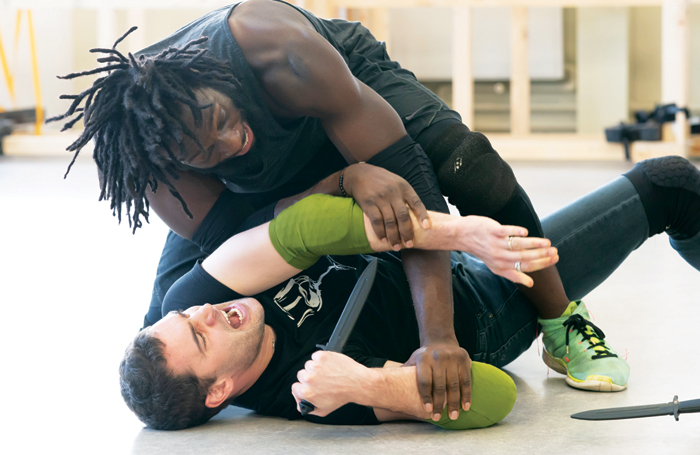 Tom Bateman (bottom) and Theo Ogundipe in rehearsals for Coriolanus at Sheffield Crucible. Photo: Johan Persson