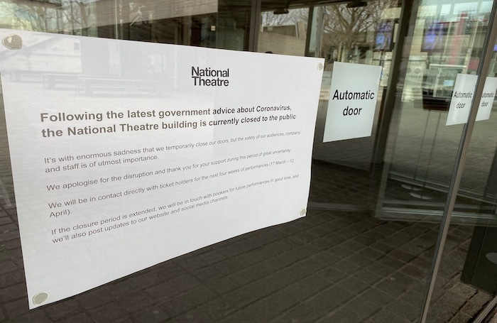 A notice about coronavirus issued by the National Theatre in London. Photo: Alistair Smith