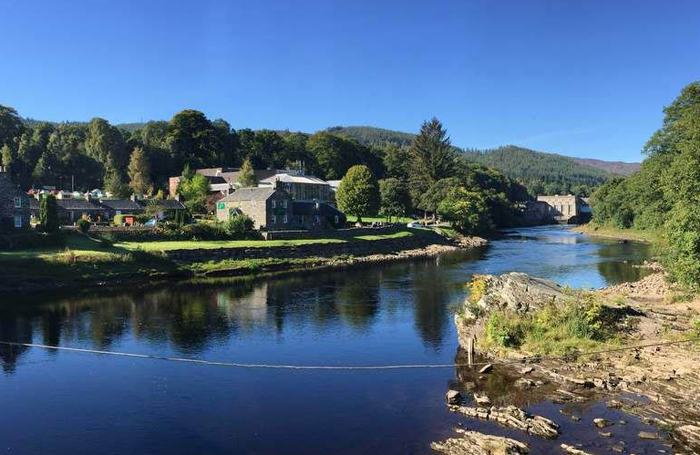 The view of Pitlochry Festival Theatre from across the River Tummel