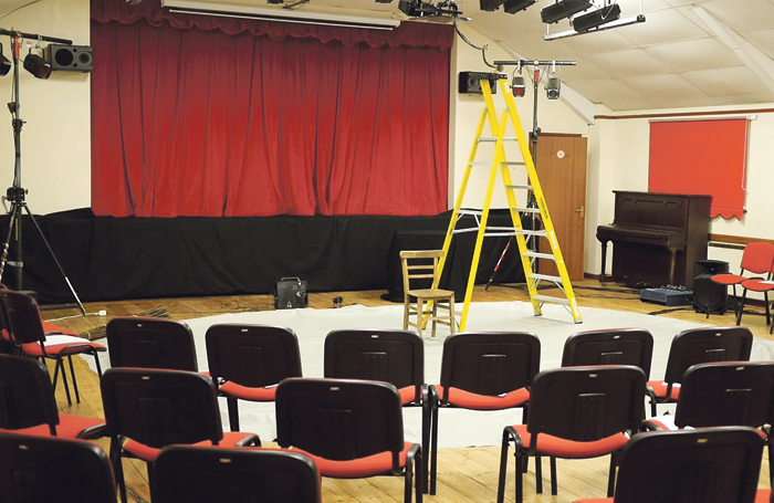 Setting up for a performance at Drimpton Village Hall in Somerset