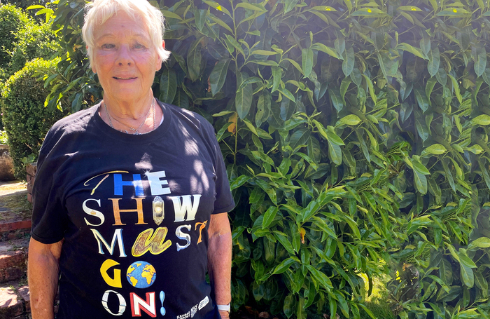 Judi Dench wearing a 'The Show Must Go On' T-shirt