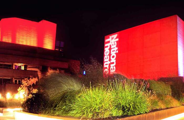National Theatre, London, lit up in red