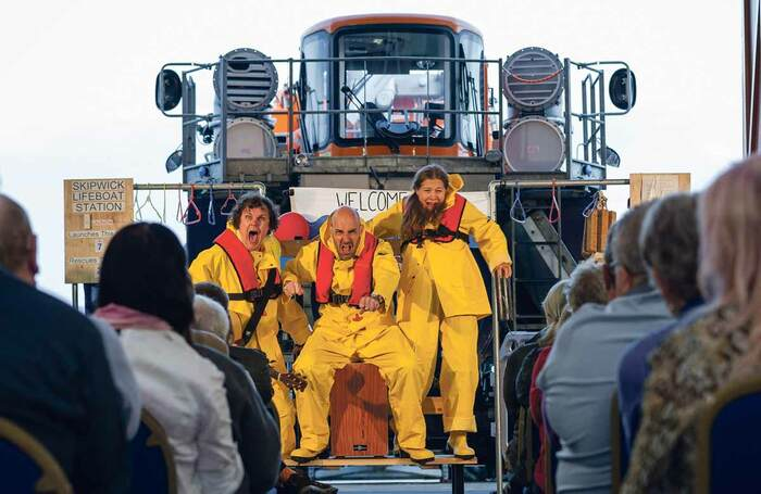 In at the Deep End in front of Scarborough's Shannon Lifeboat, performed by Mikron Theatre and represented by Duncan Clarke. Photo: Peter Poyd